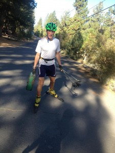 Spencer returns home from rollerskiing, briefcase in hand